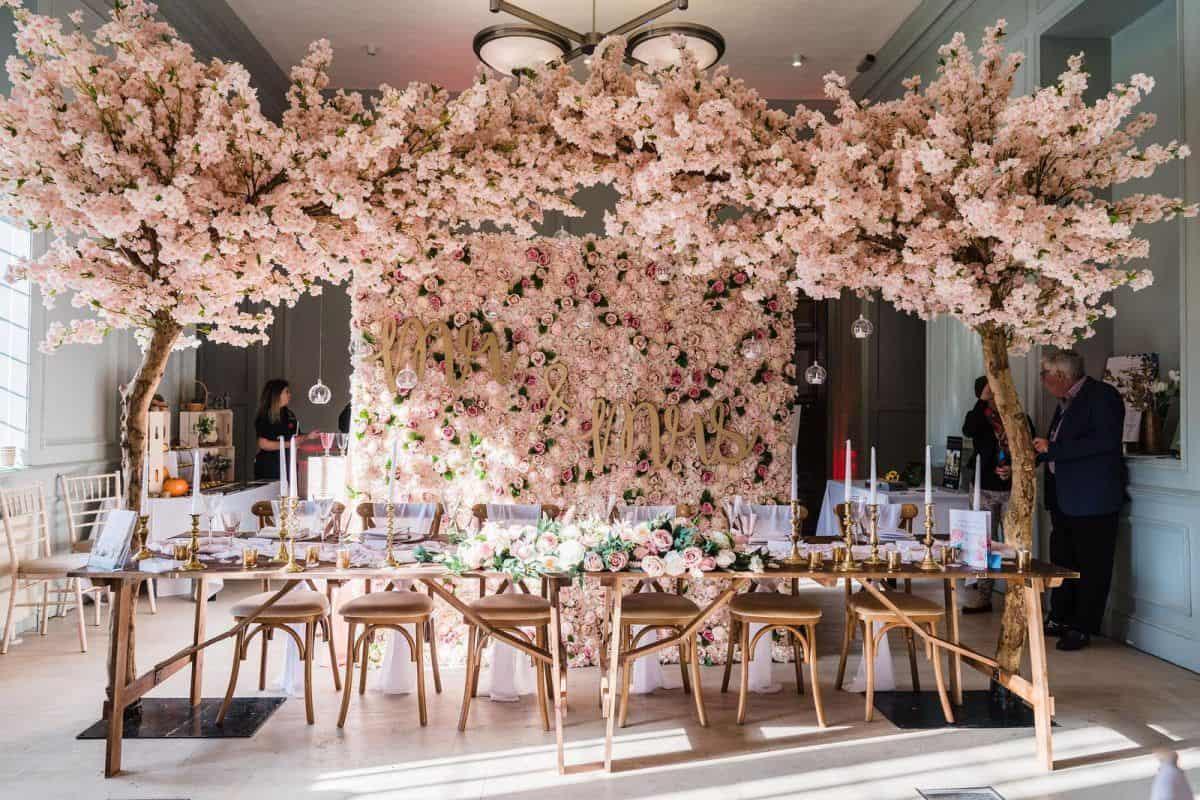 pink cherry blossom tree wedding arch
