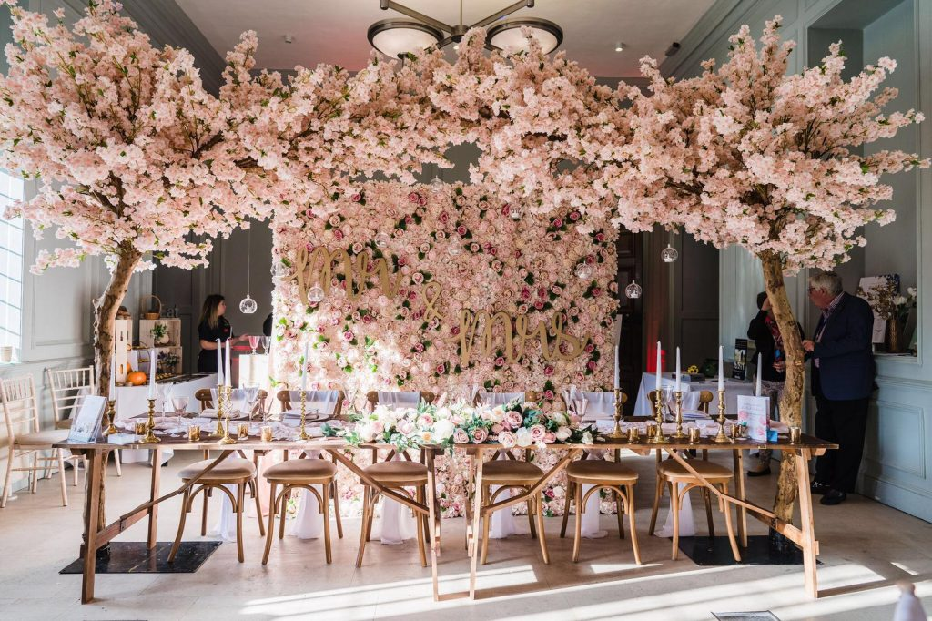 pink blossom tree wedding arch hire