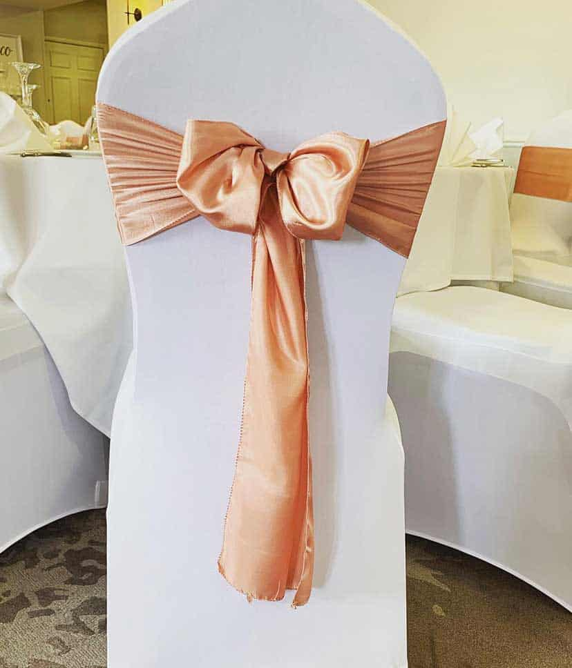 white chair cover and silk sash