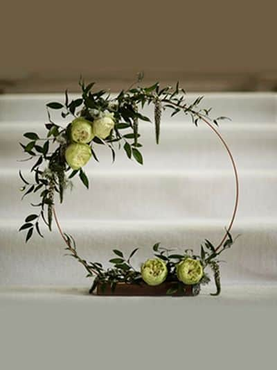 Rustic copper hoop wedding centrepiece