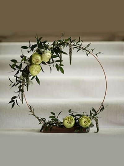 Rustic copper hoop wedding centrepiece
