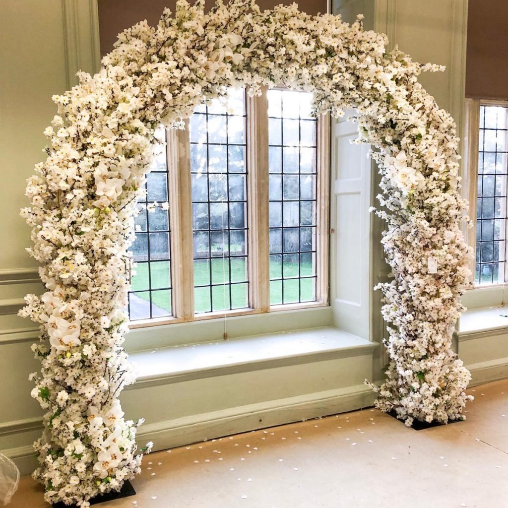rustic white blossom and orchid wedding arch hire