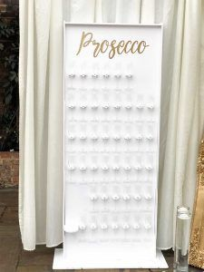 White and gold prosecco wall